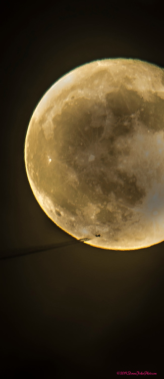 An airplane flies in front of the last full moon of the year as it rises over the Lehigh Valley Mall along MacArthur Road in Whitehall Township, Lehigh County, Pa. Thursday, December 12, 2019. It is also known as the Long Night's Moon or Cold Moon. <br /> - Photography by Donna Fisher<br /> - ©2019 - Donna Fisher Photography, LLC                      - donnafisherphoto.com