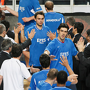 Efes Pilsen's Kerem GONLUM (F) and Ender ASLAN (B) during their Turkish Basketball Legague Play-Off semi final first match Fenerbahce between Efes Pilsen at the Sinan Erdem Arena in Istanbul Turkey on Tuesday 24 May 2011. Photo by TURKPIX