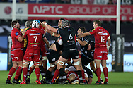a fight breaks out. Guinness Pro14 rugby match, Ospreys v Scarlets at the Liberty Stadium in Swansea, South Wales on Saturday 7th October 2017.<br /> pic by Andrew Orchard, Andrew Orchard sports photography.