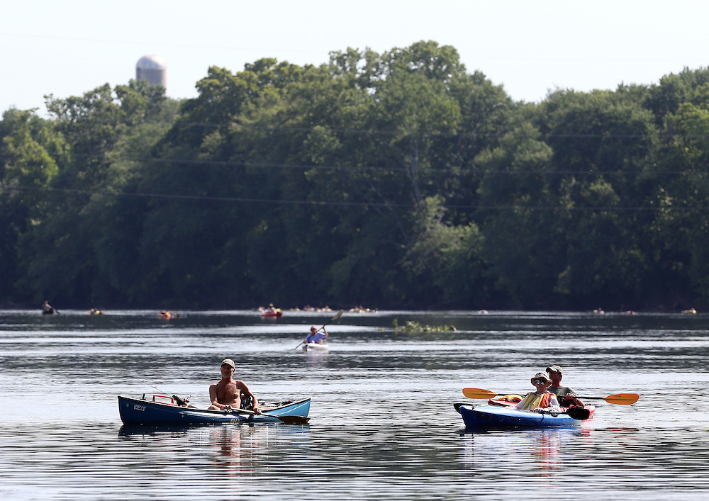 Kayakers paddle down the James River on a warm summer day in Scottsville, Va. Photo/Andrew Shurtleff