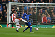 N'Golo Kante of Chelsea goes past a tackle from Joe Allen of Stoke city. Premier league match, Stoke City v Chelsea at the Bet365 Stadium in Stoke on Trent, Staffs on Saturday 18th March 2017.<br /> pic by Andrew Orchard, Andrew Orchard sports photography.