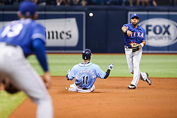 July 23, 2017 - St. Petersburg, Florida, U.S. - WILL VRAGOVIC   |   Times.Tampa Bay Rays shortstop Adeiny Hechavarria (11) forced out as Texas Rangers shortstop Elvis Andrus (1) turns the double play on the grounder by Tampa Bay Rays center fielder Mallex Smith (0) in the second inning of the game between the Texas Rangers and the Tampa Bay Rays at Tropicana Field in St. Petersburg, Fla. on Sunday, July 23, 2017. (Credit Image: © Will Vragovic/Tampa Bay Times via ZUMA Wire)