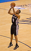 June 2, 2012; Oklahoma City, OK, USA; San Antonio Spurs guard Tony Parker (9) takes a shot during a playoff game against the Oklahoma City Thunder at Chesapeake Energy Arena.  Thunder defeated the Spurs 109-103 Mandatory Credit: Beth Hall-US PRESSWIRE