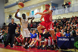 Bristol Academy Flyers' Doug McLaughlin-Williams attempts to keep the ball inside the area of play - Photo mandatory by-line: Dougie Allward/JMP - Tel: Mobile: 07966 386802 23/03/2013 - SPORT - Basketball - WISE Basketball Arena - SGS College - Bristol -  Bristol Academy Flyers V Essex Leopards