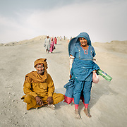 """Pilgrims arriving at one of the volcano. The area around Chandragup (meaning """"Moon Well""""), a sacred site to Hindu of 3 mud volcanoes (mainland Asia's largest ones)."""