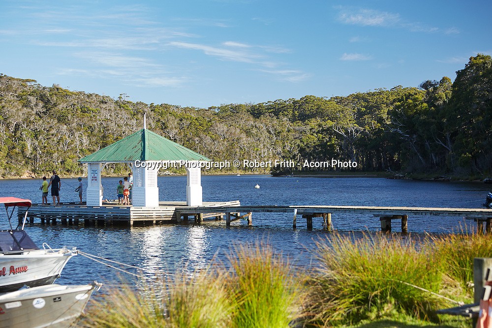 The jetty and gazebo at the end of Rest Point Road sits on Walpole Inlet