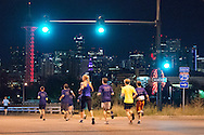 Runners in the first mile of the course run in front of the city skyline at the Red Bull Wings For Life World Run in Denver, CO, USA on 4 May, 2014. ©Brett Wilhelm