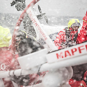 Leg 02, Lisbon to Cape Town, day 17, on board MAPFRE, Sophie Ciszek at the stern holding the main sheet, Pablo Arrarte backwards to the splashing water. Photo by Ugo Fonolla/Volvo Ocean Race. 21 November, 2017