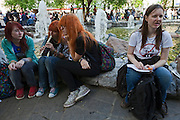 Moscow, Russia, 15/05/2012..Protesters, one wearing an anti-Putin shirt, in Chistiye Prudy, or Clean Ponds, as a Moscow court ordered the eviction of some 200 opposition activists who have set up camp in the city centre park.