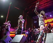"""WASHINGTON, DC - August 23rd, 2014 - Quavo , Offset and Takeoff of Atlanta rap trio Migos perform at the 3rd annual Trillectro Music Festival at RFK Stadium in Washington, D.C. The group is known for their singles """"Versace"""" and """"Hannah Montana."""" (Photo by Kyle Gustafson / For The Washington Post)"""