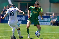 May 13, 2018 - Portland, OR, U.S. - PORTLAND, OR - MAY 13: Portland Timbers midfielder Diego Valeri dribbles past Seattle Sounders defender Kelvin Leerdam during the Portland Timbers 1-0 victory over the Seattle Sounders on May 13, 2018, at Providence Park in Portland, OR. (Photo by Diego Diaz/Icon Sportswire) (Credit Image: © Diego Diaz/Icon SMI via ZUMA Press)
