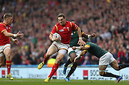 George North of Wales runs past Fourie Du Preez the South Africa captain. Rugby World Cup 2015 quarter final match, South Africa v Wales at Twickenham Stadium in London, England  on Saturday 17th October 2015.<br /> pic by  John Patrick Fletcher, Andrew Orchard sports photography.