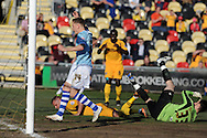 Newport county's Harry Worley (on ground) scores an own goal for Exeter's first goal. Skybet football league two match, Newport county v Exeter city at Rodney Parade in Newport, South Wales on Sunday 16th March 2014.<br /> pic by Andrew Orchard, Andrew Orchard sports photography.