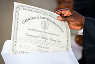 A graduate reviews his certificate of accomplishment during graduation on Saturday, March 14, 2015, at the Evangelical Lutheran Church in Tanzania – South-East of Lake Victoria Diocese's (ELCT-SELVD) Ebenezer Cathedral in Shinyanga, Tanzania.  LCMS Communications/Erik M. Lunsford