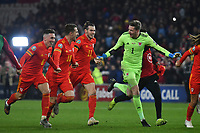 Football - 2019 / 2020 UEFA European Championships Qualifier - Group E: Wales vs. Hungary<br /> <br /> Harry Wilson of Wales, Aaron Ramsey of Wales  Gareth Bale of Wales & Wayne Hennessey of Wales celebrate Wales' victory & qualification for Euro 2020 , at Cardiff City Stadium.<br /> <br /> COLORSPORT/WINSTON BYNORTH