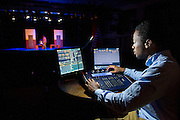A NSU student works the board during a rehearsal at Brown Hall Theatre