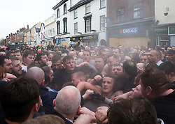© Licensed to London News Pictures. 28/02/2017. Atherstone, UK.  A cloud of steam comes from a group of sweaty competitors as they fight over the ball during the Atherstone Ball Game on Shrove Tuesday, a tradition that dates from the 12th century, in which the locals fight over a ball up and down the streets town in Warwickshire. Photo credit: ISABEL INFANTES / LNP