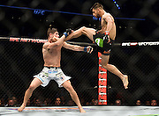 MEXICO CITY, MEXICO - JUNE 13:  (R-L) Yair Rodriguez of Mexico kicks Charles Rosa of the United States in their featherweight bout during the UFC 188 event at the Arena Ciudad de Mexico on June 13, 2015 in Mexico City, Mexico. (Photo by Jeff Bottari/Zuffa LLC/Zuffa LLC via Getty Images)