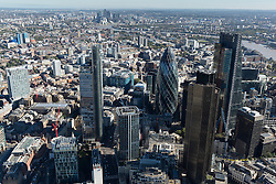 © Licensed to London News Pictures. 26/04/2016. London, UK. Moorgate area of the City of London with continued building projects underway. The city of London bathes in the Autumn sunshine. Photo credit: Martin Apps/LNP