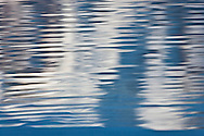 Mount Adams is reflected in ripples on the surface of Takhlakh Lake in the Gifford Pinchot National Park, WA state, USA