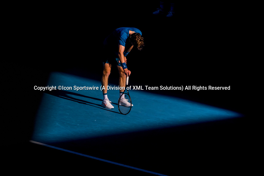 MELBOURNE, VIC - FEBRUARY 17: Andrey Rublev of Russia shows his exhaustion after a period of play during the quarterfinals of the 2021 Australian Open on February 17 2021, at Melbourne Park in Melbourne, Australia. (Photo by Jason Heidrich/Icon Sportswire)