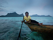 Solpan, a fisherman, at dusk, off Bodgaya island.