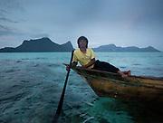 Solpan, a fisherman, at dusk, off Bodgaya island.