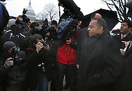 Roland Burris surrounded by lawyers, press and police on Capitol Hill, Washington, DC. on January  6, 2009.  Photograph: Dennis Brack