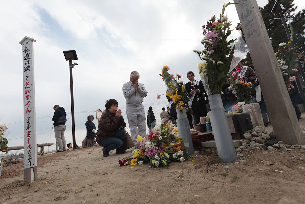 People lay flowers and perform a remembrance ceremony and pray at a shrine on Hiyoriyama  or Weather Hill to remember victims of the tsunami at  Miyagi, Japan. Friday March 11th 2016. 2016 marks the fifth anniversary of the Great East Japan earthquake. This magnitude 9 quake caused a tsunami that flattened large parts of the Tohoku coast killing around 18,000 people and triggering a nuclear disaster at Fukushima Daichi Power Station.