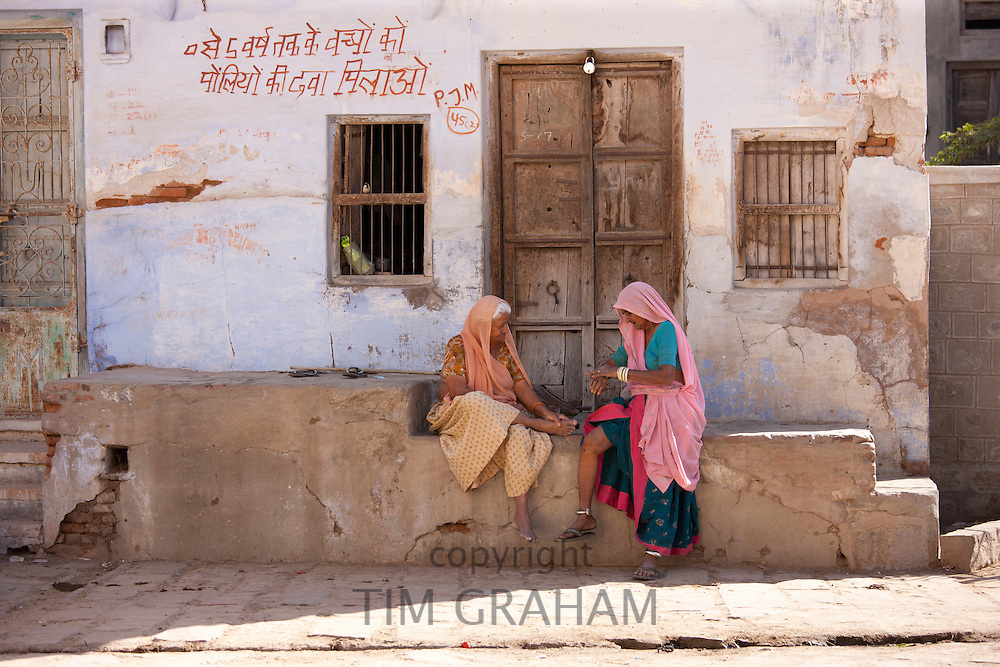 Indian local women chatting in Narlai village in Rajasthan, Northern India