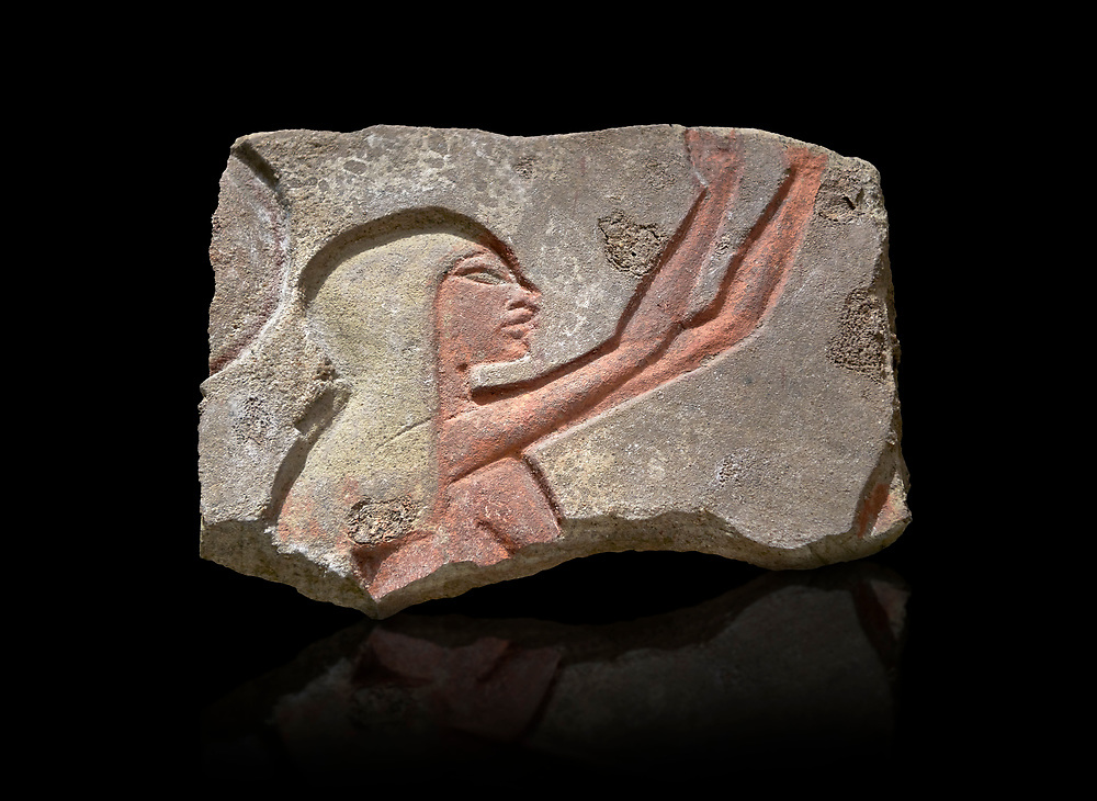 Ancient Egyptian Talatat block with a female worhiper of tambourine player relief, sandstone, New Kingdom, 18th Dynasty (1353-1336 BC), Thebes, Karnac. Egyptian Museum, Turin. Black background<br /> <br /> The talatat was introduced to increase the speed new monuments to Aten could be built. The talatat were smaller, about 52x26x24 cm, than the usual building blocks used and therfore were easier to handle and build with. They were first used on the new buildings of Akhenaten at Thebes during his reign, the, after his capital was moved , for the monumenta of Amarna. When Amon was restored all the Aten temples were taken down and their blocks used in other buildings. Over 100,000 talatat have been excavated so far in Thebes and they represent a massive jigsaw puzzle as archaeologist try to piece them together into their original reliefs. .<br /> <br /> If you prefer to buy from our ALAMY PHOTO LIBRARY  Collection visit : https://www.alamy.com/portfolio/paul-williams-funkystock/ancient-egyptian-art-artefacts.html  . Type -   Turin   - into the LOWER SEARCH WITHIN GALLERY box. Refine search by adding background colour, subject etc<br /> <br /> Visit our ANCIENT WORLD PHOTO COLLECTIONS for more photos to download or buy as wall art prints https://funkystock.photoshelter.com/gallery-collection/Ancient-World-Art-Antiquities-Historic-Sites-Pictures-Images-of/C00006u26yqSkDOM