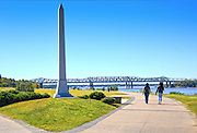 Tom Lee Park overlooks the Mississippi riverfront in Memphis and is a popular recreational area.  The granite monument was erected to Tom Lee, a riverworker who saved the lives of 32 passengers of the sinking of steamboat M.E. Norman in 1925.  The Frisco Bridge, a railroad bridge, can be seen in the background.