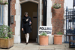 © Licensed to London News Pictures. 07/05/2015. London, UK. A voter arrives at their local polling station station in Brick Lane, Tower Hamlets, east London today. Photo credit : Vickie Flores/LNP