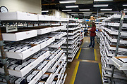 Completed rings are sorted and boxed inside the Josten's factory in Denton, Texas on December 12, 2017. (Cooper Neill for The New York Times)
