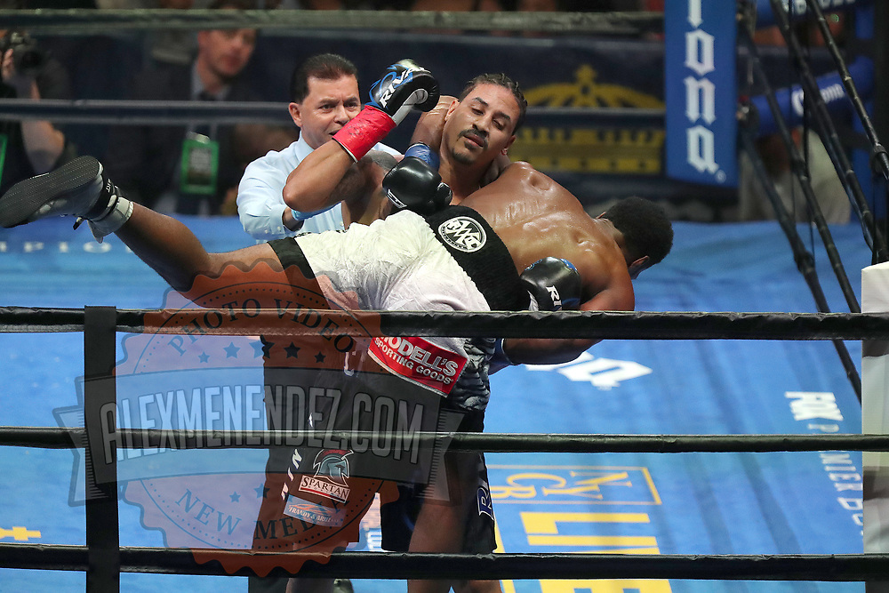 Marcus Browne is lifted off the canvas by Lenin Castillo during a Premier Boxing Champions fight on Saturday, August 4, 2018 at the Nassau Veterans Memorial Coliseum in Uniondale, New York.  (Alex Menendez via AP)