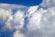 Aerial view of puffy cumulus clouds at cloud level (about 30,000 Feet)