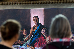 © Licensed to London News Pictures. 04/07/2020. ST ALBANS, UK.  Visitors view a version of the Last Supper, with Jesus as a black man, at St Albans Cathedral in support of Black Lives Matter.  The 8ft 8in-high (2.6m) high-resolution print of Lorna May Wadsworth's version of Leonardo da Vinci's 15th century masterpiece is on display above the Altar of the Persecuted in the North Transept of the cathedral and shows Tafari Hinds, a Jamaican model, as Jesus The artwork is part of a prayer installation to mark the cathedral's reopening after coronavirus pandemic lockdown restrictions were eased by the UK government.  Photo credit: Stephen Chung/LNP