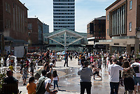 Kids keeping cool in the  new coventry precinct fountain on the opening day of the Coventry city of culture 2021 photo by Mark Anton Smith