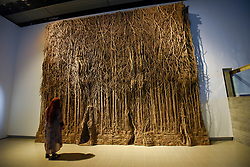 "© Licensed to London News Pictures. 02/03/2020. LONDON, UK. A staff member views ""Foret Palatine"", 2019-20, by Eva Jospin. Preview of ""Among The Trees"" exhibition at the Hayward Gallery on the Southbank.  Artworks by 38 international artists explore man's relationship with trees and forests at a time when the destruction of forests is accelerating in show which runs 4 March to 17 May 2020.  Photo credit: Stephen Chung/LNP"