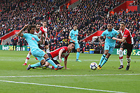 Football - 2017 / 2018 Premier League - Southampton vs. AFC Bournemouth<br /> <br /> Bournemouth's Nathan Ake gets a shot on goal well saved by Southampton's Alex McCarthy at St Mary's Stadium Southampton<br /> <br /> COLORSPORT/SHAUN BOGGUST
