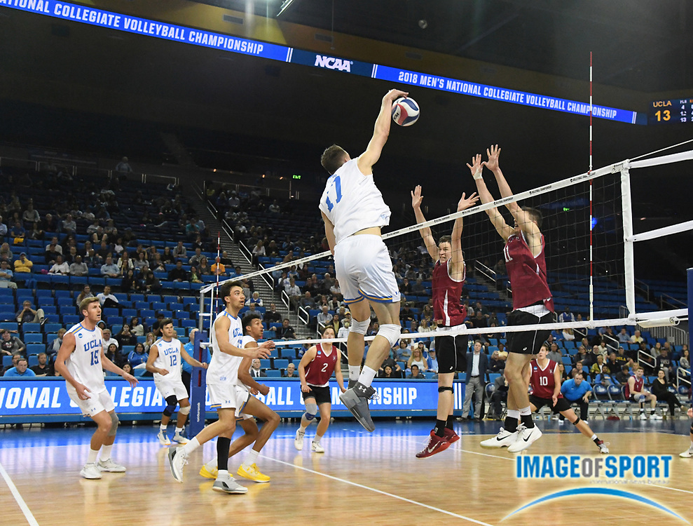 UCLA Bruins opposite hitter Christian Hessenauer (17) spikes the ball against the Harvard Crimson during the opening round game of the NCAA college volleyball championship in Los Angeles, Tuesday, May 1, 2018. UCLA defeated Harvard 23-25, 25-21, 25-11, 25-21.