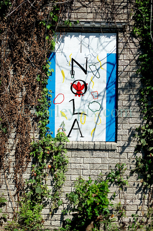 26 August 2015. New Orleans, Louisiana. <br /> Hurricane Katrina revisited. A decade passes.<br /> A decade later and a sign 'NOLA' (New Orleans Louisiana) is painted on the boarded up window of an abandoned house in the Lower 9th Ward. The Lower 9 was one of the areas hardest hit by Katrina.<br /> Photo credit©; Charlie Varley/varleypix.com.