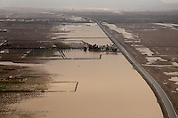 Floods lap against Afghanistan's HIghway One, after days of heavy rains in Zhari District, west of Kandahar City. US troops from the 101st Airborne Division have been battling to keep the road open and free from Taleban attacks.