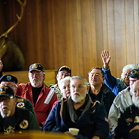 011215  Adron Gardner/Independent<br /> <br /> Guests raise their hands to ask questions of the Director of the New Mexico Veterans Health Care System Andrew Welch during a town hall meeting at the Elks Club in Gallup Monday.