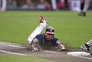 July 23, 2001 - Cleveland, Ohio - Cleveland Indians second baseman Roberto Alomar slides head-first into first base in a MLB game against the Chicago White Sox at Jacobs Field in Cleveland Ohio. Alomar was elected to the National Baseball Hall of Fame on Jan. 6, 2011.