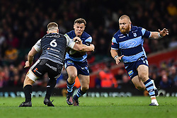 27th April 2019 , Principality Stadium , Cardiff, Wales ; Guinness pro 14's, Round 21, Cardiff Blues Vs Ospreys ; Jarrod Evans of Cardiff Blues is tackled by Olly Cracknell of Ospreys<br /> <br /> Credit :  Craig Thomas/Replay Images