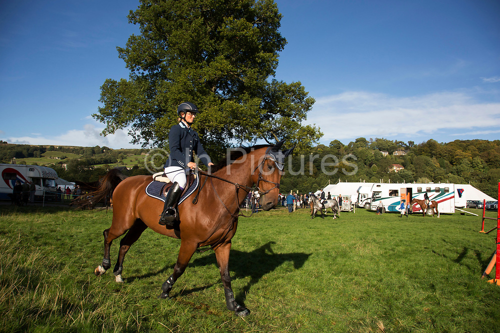 Competitors prepare themselves and their horses for the show jumping competition. 'Pateley Show', as the Nidderdale Show is affectionately known, is a traditional Dales agricultural show for the finest livestock, produce and crafts in the Yorkshire Dales. Held in the picturesque surrounds of Bewerley Park, Pateley Bridge, is one of the county's foremost shows. It regularly attracts crowds of 17,000 and traditionally marks the end of the agricultural show season.