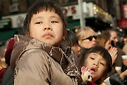 Young spectators wait for the parade to begin.