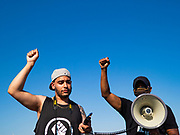 17 JUNE 2020 - NORWALK, IOWA: Supporters of Black Lives Matter put their fists in the air during a protest in Elizabeth Holland Park in Norwalk. About 400 supporters of Black Lives Matter marched through Norwalk, IA, an upper class suburb of Des Moines Wednesday. Norwalk has a population of about 10,000 and, according to the US Census Bureau, is 97 percent white. The marchers were protesting police violence against people of color. The march was a reaction to the police killing of George Floyd in Minneapolis in May. The march was peaceful.         PHOTO BY JACK KURTZ