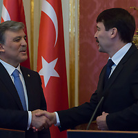 Abdullah Gul (L) president of Turkey shakes hands with his Hungarian counterpart Janos Ader (R) after a press conference in Budapest, Hungary on February 17, 2014. ATTILA VOLGYI